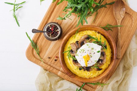 Breakfast. Polenta with mushrooms and poached egg. Flat lay. Top view. Stock Photo - 82112276