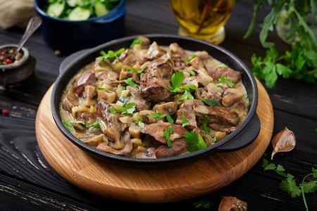 Stroganoff chicken liver with mushrooms and cream