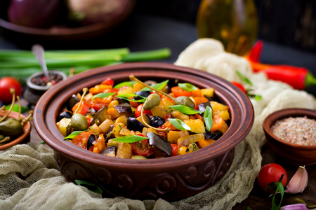 Hot spicy stew (caponata) eggplant, zucchini, sweet pepper, tomato, carrot, onion, olives and capers Stock fotó