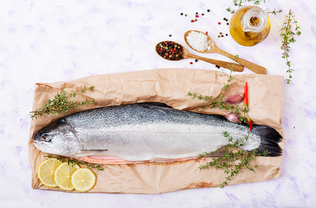 Fresh raw salmon red fish  on a light  background. Flat lay. Top view Standard-Bild