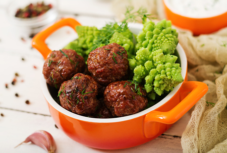 Baked beef meatballs and garnish from boiled cabbage romanesko. Dietary menu. Proper nutrition. Stock Photo