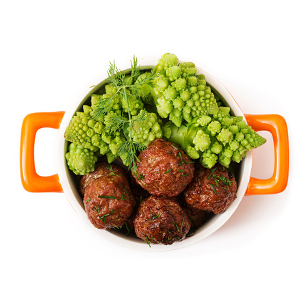 Baked beef meatballs and garnish from boiled cabbage romanesko. Dietary menu. Proper nutrition. Flat lay. Top view