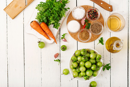 pickling: Ingredients for Korean salad from green tomatoes and carrots. Flat lay. Top view Stock Photo