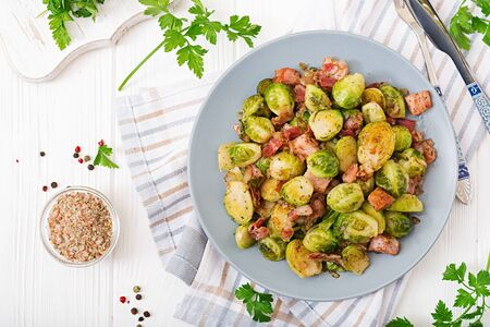 Brussels sprouts. Roasted Brussels sprouts with bacon. Delicious lunch. Flat lay. Top view