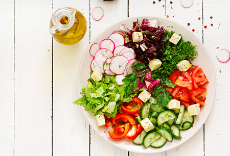 Mix salad from fresh vegetables and greens herbs. Dietary menu. Proper nutrition. Healthy lifestyle. Flat lay. Top view
