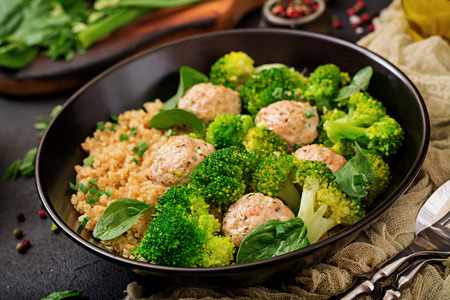 Baked meatballs of chicken fillet with garnish with quinoa and boiled broccoli. Proper nutrition. Sports nutrition. Dietary menu Stock Photo