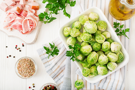 Brussels sprouts. Preparation for roasting Brussels sprouts with bacon. Flat lay. Top view
