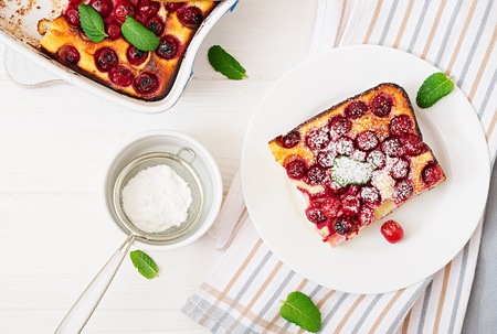Cottage cheese casserole with cherries. Flat lay. Top view