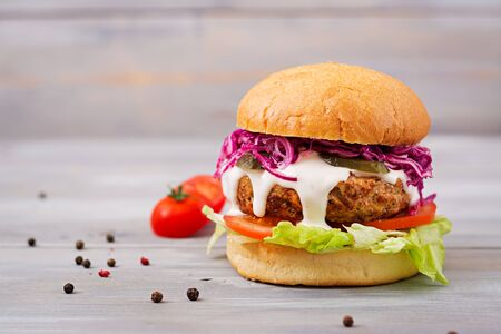 Sandwich hamburger with juicy burgers, tomato and red cabbage Stock Photo