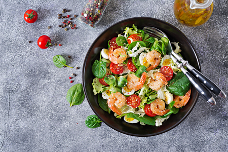 Healthy salad plate. Fresh seafood recipe. Grilled shrimps and fresh vegetable salad and egg. Grilled prawns. Healthy food. Flat lay. Top view