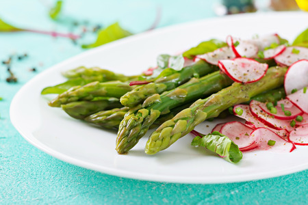 Salad from asparagus with radish and chard. Vegan cuisine. Healthy food.