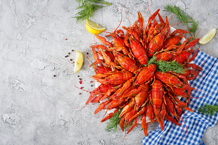 Crayfish. Red boiled crawfishes on table in rustic style, closeup. Lobster closeup. Border desig. Top view
