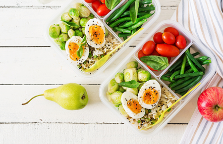 Vegetarian meal prep containers with eggs, brussel sprouts, green beans and tomato. Dinner in lunch box. Top view. Flat lay 免版税图像 - 107873053