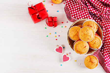 Muffins with pumpkin. Cupcakes with Valentines Day decor. Flat lay. Top view.