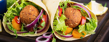 Tortilla wrap with falafel and fresh salad. Vegan tacos. Vegetarian healthy food. Banner