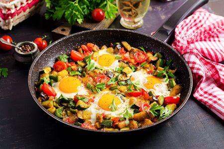 Late breakfast - fried eggs with vegetables. Shakshuka. Arabic cuisine. Kosher food. 写真素材
