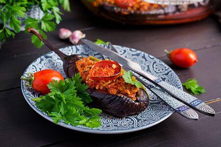 Karniyarik - turkish traditional aubergine eggplant meal. Stuffed eggplants with ground beef and vegetables baked with tomato sauce. Turkish cuisine.