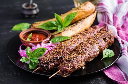 Kebab adana,  lamb and beef and toasts with pesto sauce. 版權商用圖片
