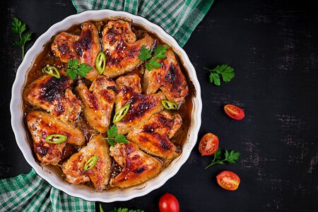 Baked chicken wings in the Asian style on baking dish. Top view, overhead 版權商用圖片