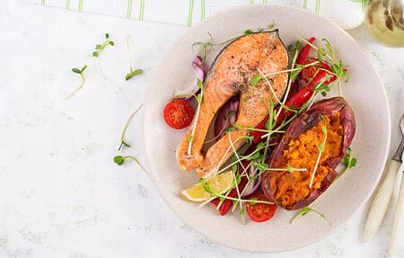 Healthy food: baked salmon and sweet potato and vegetables. Top view , overhead. Diet menu. Copy space