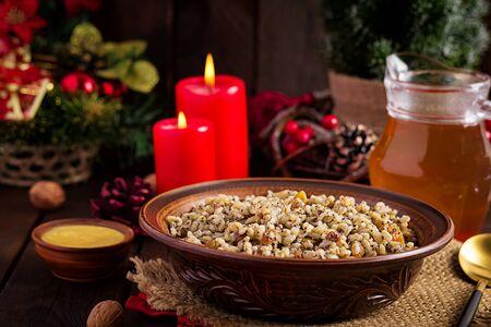 Kutya. Christmas porridge made of wheat grains, poppy seed, nuts, raisins and honey. Christmas kutia. Ukrainian cuisine.