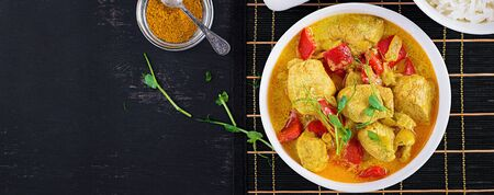 Indian chicken curry with basmati rice in bowl.  Traditional Indian dish. Chicken tikka masala. Indian cuisine. Top view, banner