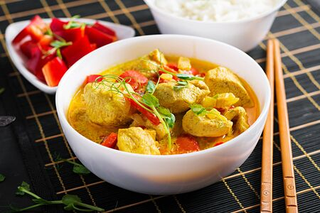 Indian chicken curry with basmati rice in bowl.  Traditional Indian dish. Chicken tikka masala. Indian cuisine.