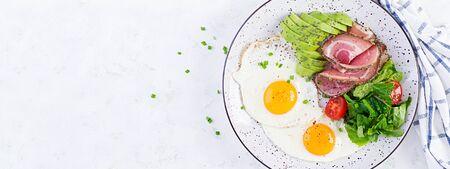 Ketogenicpaleo diet. Fried eggs, ham, avocado and fresh salad.  Keto breakfast. Brunch.  Top view, banner Zdjęcie Seryjne