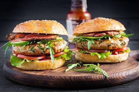 Big sandwich - hamburger burger with turkey meat, tomato, bacon and lettuce. Reklamní fotografie