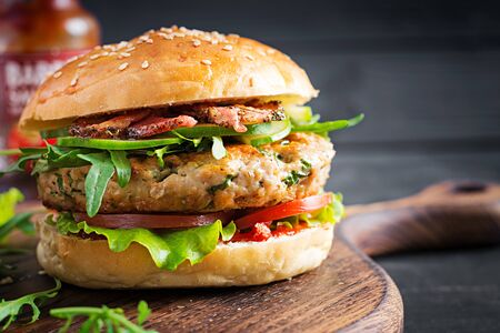 Big sandwich - hamburger burger with turkey meat, tomato, bacon and lettuce.