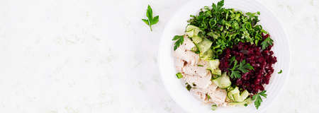Trendy salad. Chicken boiled fillet with salad beetroot and cucumber. Healthy food, ketogenic diet, diet lunch concept. Keto / Paleo diet menu. Top view, overhead, banner