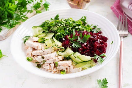 Trendy salad. Chicken boiled fillet with salad beetroot and cucumber. Healthy food, ketogenic diet, diet lunch concept. Keto / Paleo diet menu.