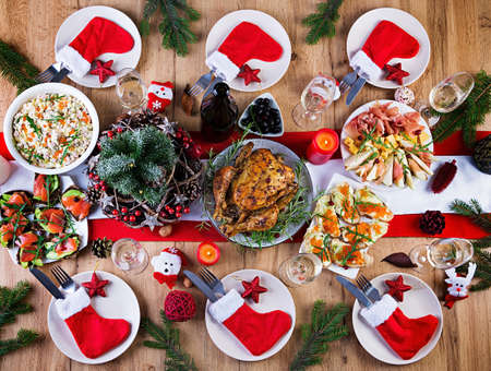 Baked turkey. Christmas dinner. The Christmas table is served with a turkey, decorated with bright tinsel and candles. Fried chicken, table. Family dinner. Top view, flat lay, overhead, copy space Stock fotó