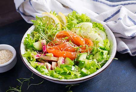 Ketogenic diet breakfast. Salt salmon salad with greens, cucumbers, celery and watermelon radish. Keto, paleo lunch