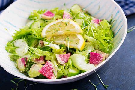Salad from watermelon radish, cucumber, celery and lettuce leaves. Vegan food. Dietary menu.