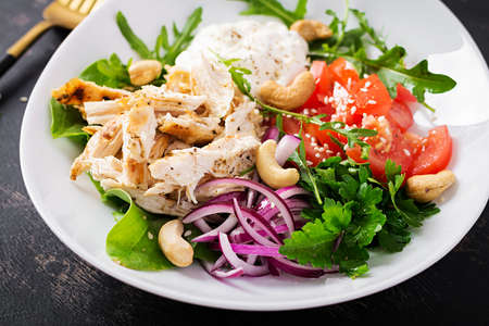 Healthy vegetable summer salad, fresh vegetables and chicken with yogurt dressing. Keto, ketogenic diet. Stock Photo
