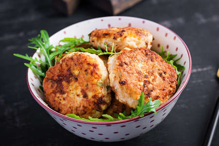 Healthy dinner. Chicken cutlets in a bowl on a dark background.