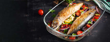 Baked mackerel with herbs and lemon and vegetables. Healthy dinner. Banner