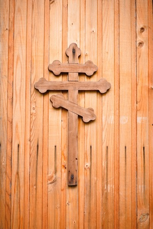 wooden cross: Wooden cross with silver detail representations of the Crucifixion on green background Stock Photo