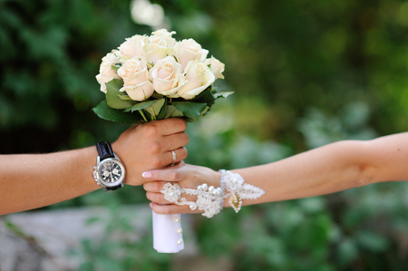 furskin: groom gives the bride a bouquet of roses