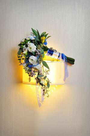 bridal bouquet: bridal bouquet on wall background
