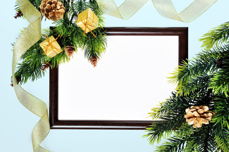 Frame paper wooden and Christmas decorations isolated on white photo