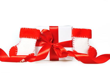 nikolaus: Gift with red ribbons and boots of Santa Claus Stock Photo