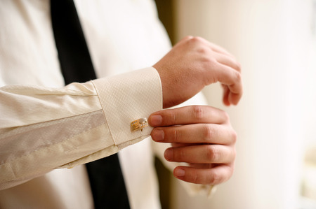 cuff link: man wears white shirt and cufflinks. Stock Photo