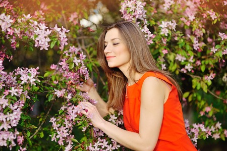 colorfully: Spring , Summer beauty. Young woman posing on a Flower Glade. Horizontal, Outdoor shot. Colorfully photography.