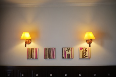 wall sconce: two wall lamps included in the room.