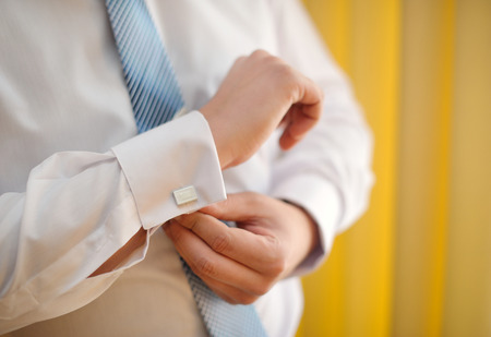 man cufflinks buttons on the sleeve shirts.