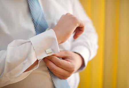 sleeve: man cufflinks buttons on the sleeve shirts.