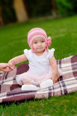 beautiful 4 month old baby girl in pink flower hat and tutu photo