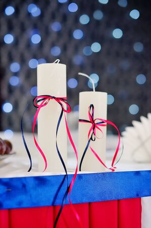 adorned: adorned decor with two candles on the background bokeh Stock Photo